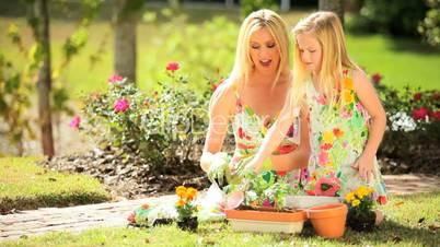 Pretty Blonde Mother & Daughter Gardening Together