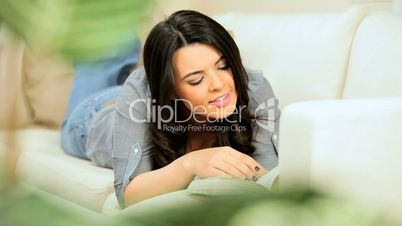 Young Girl Relaxing With a Book