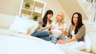 Pretty Girlfriends Watching Scary Movie with Popcorn