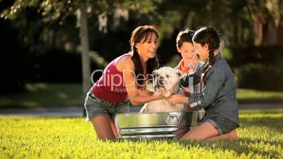 Young Mom & Children Bathing Family Bulldog