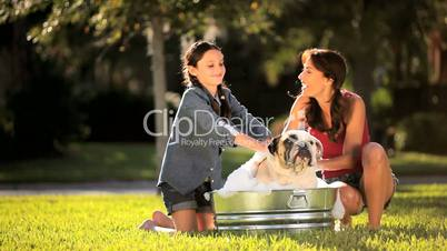 Happy Mother & Daughter Bathing Family Bulldog