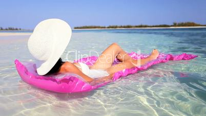 Relaxed Female Floating on Air Mattress