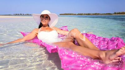 Elegant Female Floating on Air Mattress