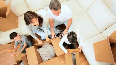 Caucasian Family Unpacking in New Home