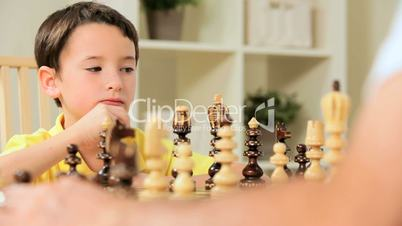 Young Caucasian Boy Playing Chess Game