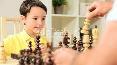 Young Boy Playing Chess with Father