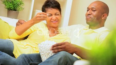 Ethnic Couple Eating Popcorn
