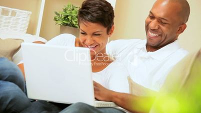 African-American Couple Using Laptop for Webchat