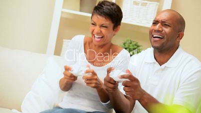 Ethnic Couple Having Fun with Electronic Games