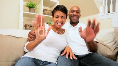 Young Ethnic Couple Using Interactive Technology