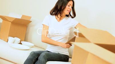 Brunette Girl Unpacking House Move Cartons