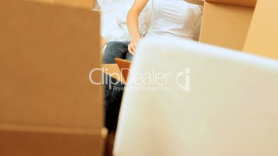 Brunette Girl Having Fun with Packing Materials