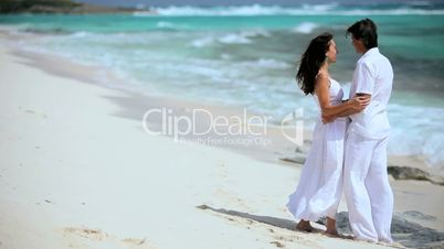 Caucasian Couple Laughing on Paradise Beach