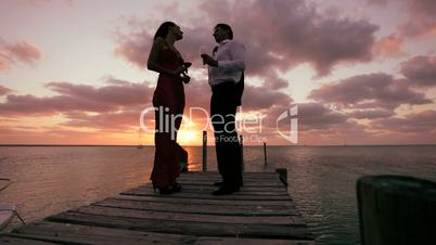 Elegant Couple at Sunset with a Glass of Wine