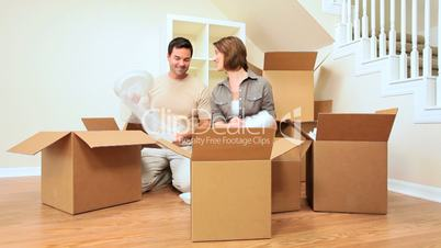 Attractive Couple Surrounded by Moving Boxes