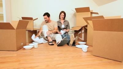 Young Couple Tired From House Moving