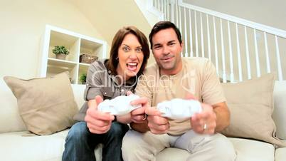 Young Couple Competing on Games Console