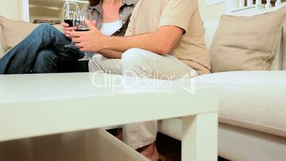 Young Couple Relaxing with a Glass of Wine