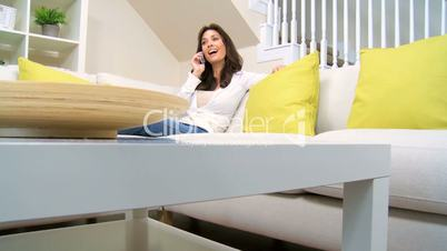 Brunette Lady Using a Cell Phone at Home