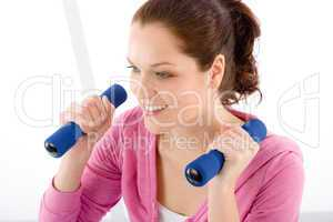 Fitness happy woman exercise dumbbell gym