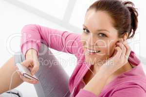 Fitness woman listen music mp3 relax