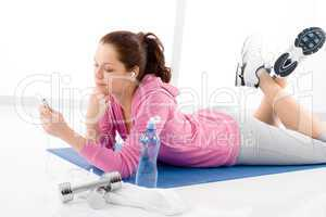 Fitness woman listen music mp3 relax gym
