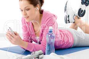 Fitness woman listen music mp3 relax gym