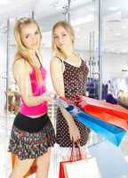 Two girls with bags - comparison shopping. Sale!