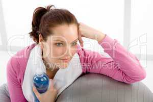 Fitness woman relax water bottle ball sportive
