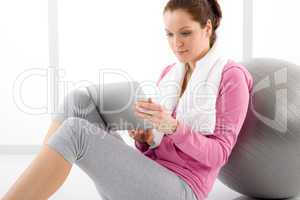 Woman touch screen computer fitness outfit
