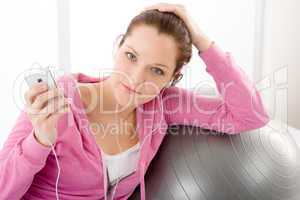 Fitness woman listen music mp3 relax
