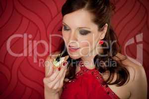 Cocktail party woman eat appetizer evening dress