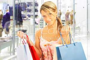 girl with bags - comparison shopping. Sale!