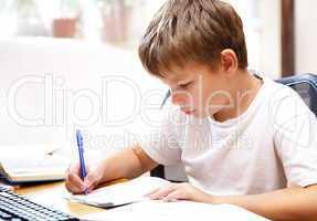 boy behind a desk