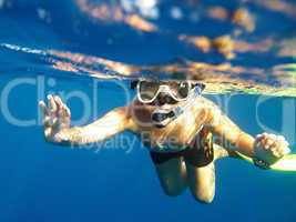 boy floats under water