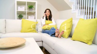 Female Relaxing With Her Cell Phone