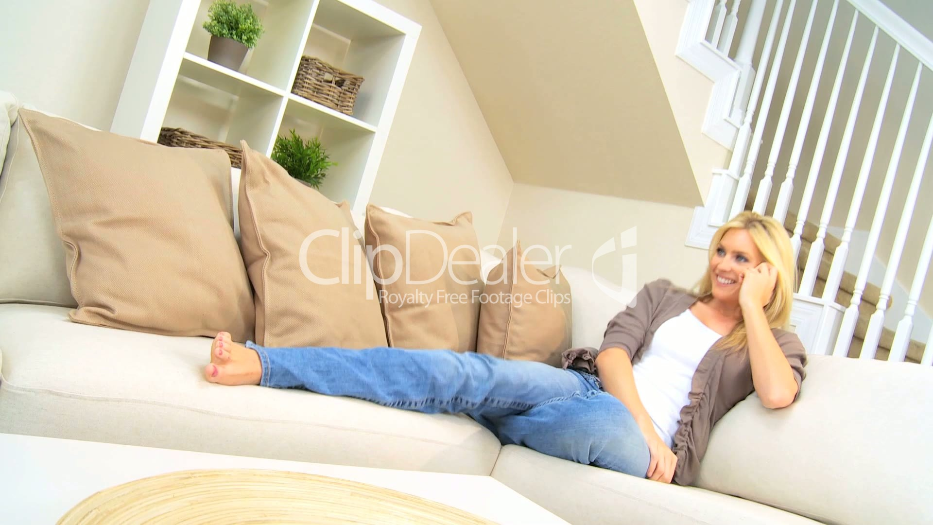 pretty girl with cell phone relaxing at home royalty free. Black Bedroom Furniture Sets. Home Design Ideas
