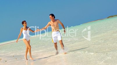 Attractive Couple in Swimwear on Island Vacation