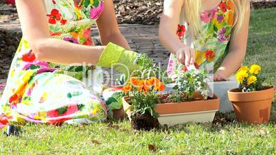 Young Mom & Daughter Working in the Garden