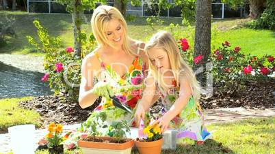Young Mom & Daughter Gardening