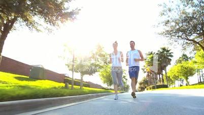 Young Couple Enjoying Jogging Exercise