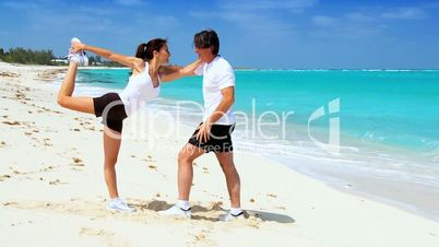 Healthy Couple Exercising on Beach