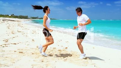 Healthy Caucasian Couple Exercising on the Beach