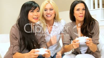 Multi-Ethnic Girlfriends Playing on Games Console