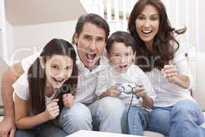 Happy Family Having Fun Playing Video Console Games