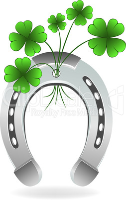 Horseshoe and four leaf clover lucky symbol.