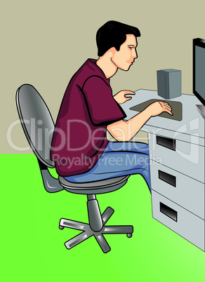Programmer sitting in front of his computer