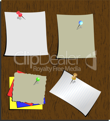 Push pins and paper notes at wood background