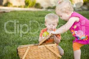 Brother and Sister Toddlers Playing with Apple and Picnic Basket