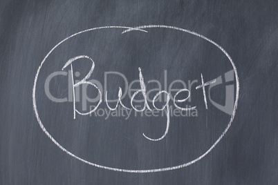 "Word ""budget"" circled on a blackboard"